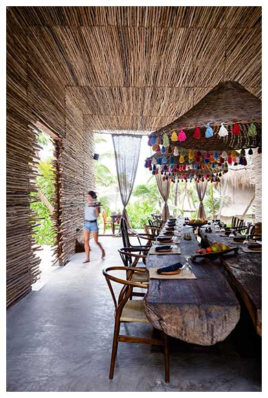 Long wooden table under covered patio for group meals